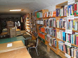 Books placed on shelves at Orthodox Community Library. Orthodox Mission Kenya Project