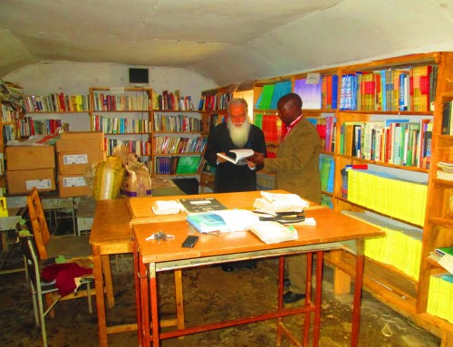Archbishop Makarios Admires books at Orthodox Mission education centre