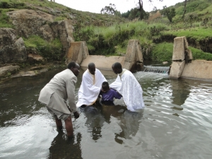 catechumen being baptised at a river near St Barnabas Orthodox Mission Kenya